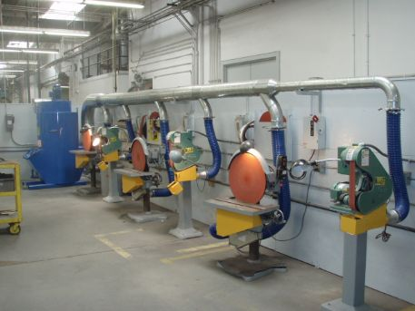 2,000 CFM Model UC-20 installed on a line of finishing tools